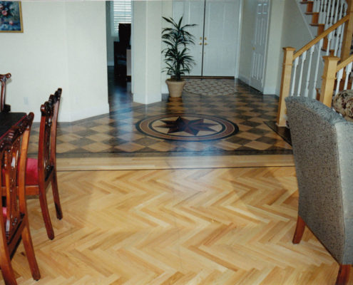 Red Oak Herringbone with Wenge feature strip, block Parquet stained to a checkerboard with Medallion.