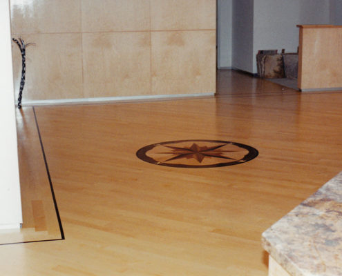 Maple Flooring with Wenge feature strip and Compass Medallion