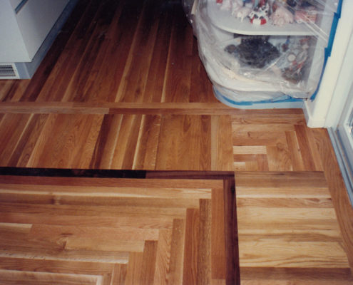 White Oak with border treatment and a log cabin flooring transition