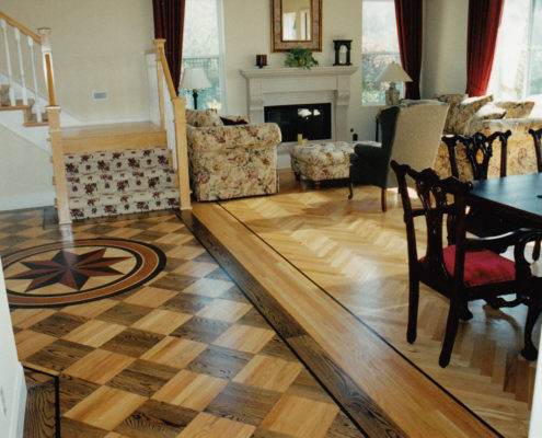 Mixed flooring in Red Oak with stained block Parquet.